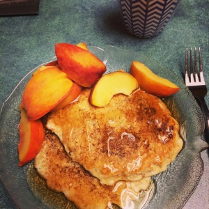 protein pancakes with sugar free syrup and a fresh peach.