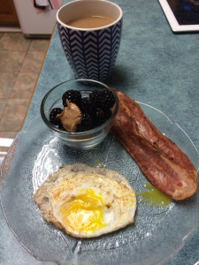 so yummy!  fried egg, turkey bacon and berries with almond butter
